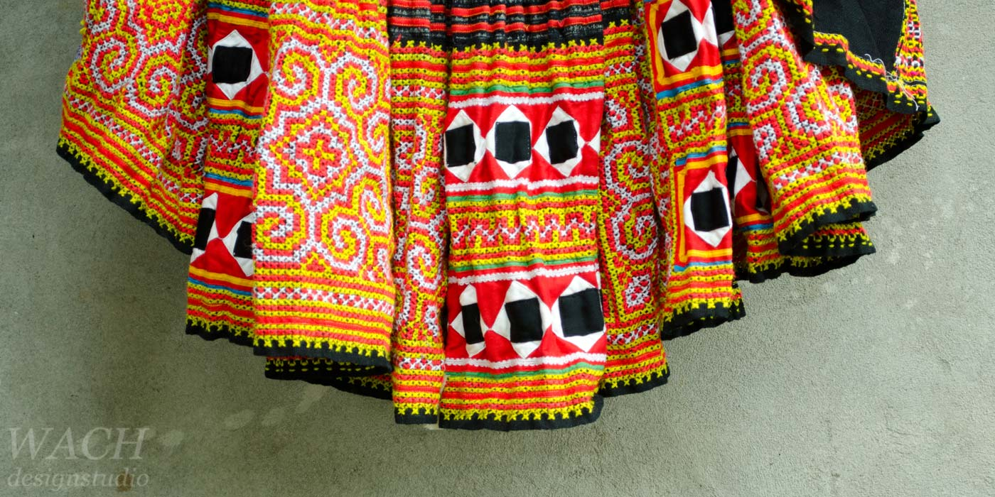 Traditional Hmong skirt with red and orange patterns