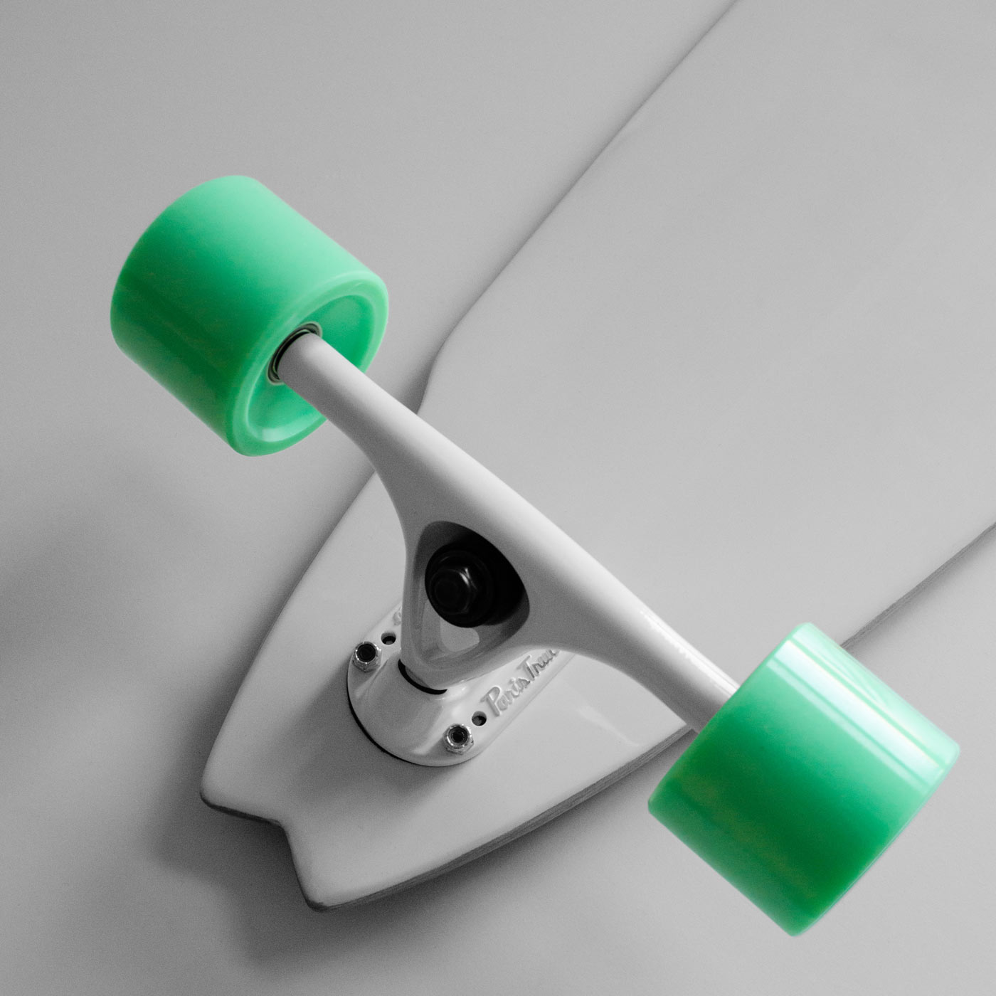 View of the WACH designstudio longboard white bottom with paris trucks and turquoise Olson&Hekmati wheels