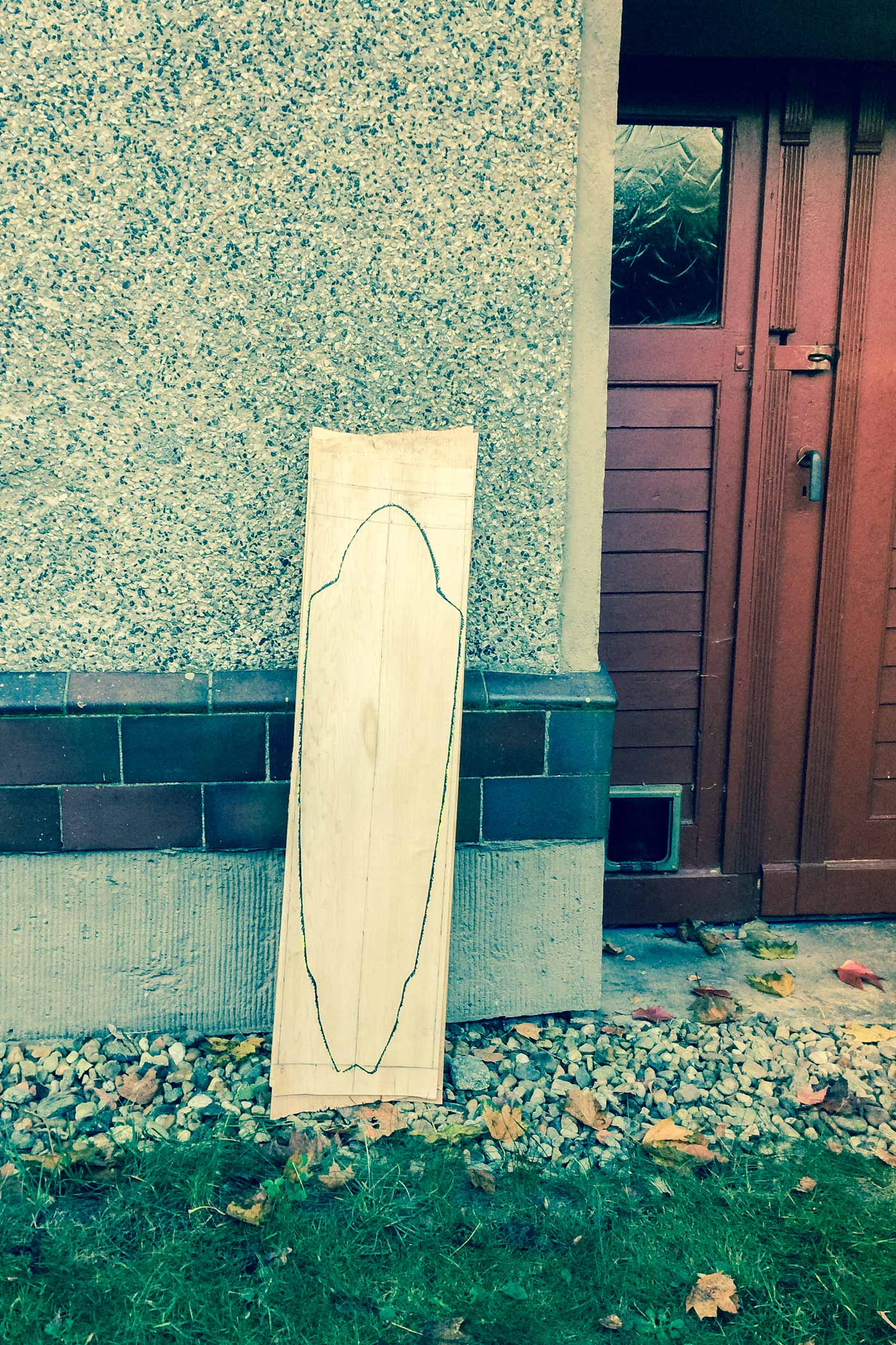 Laying down the shape of WACH designstudio longboard to be cut out