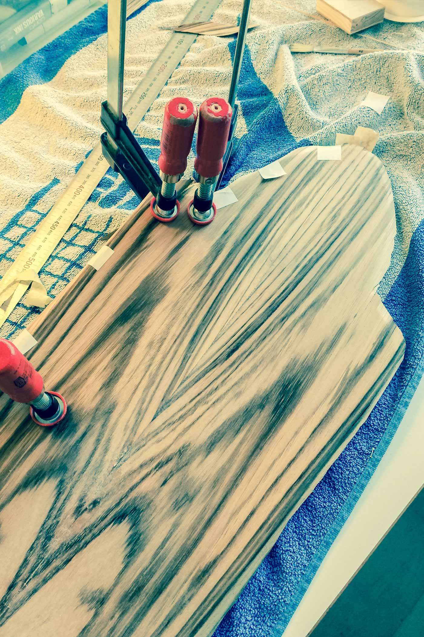 almost finished work of laying down zebra wood veneer on WACH designstudio longboard deck