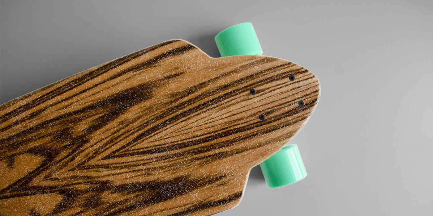 Mirrored zebra wood deck on longboard by WACH designstudio