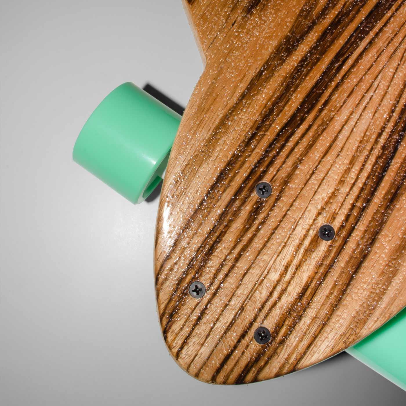Detail of the WACH designstudio longboard front deck covered with mirrored zebra wood veneer
