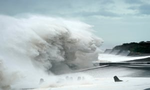 Surging waves generated by typhoon Hagibis hit the seashore in Mie prefecture.