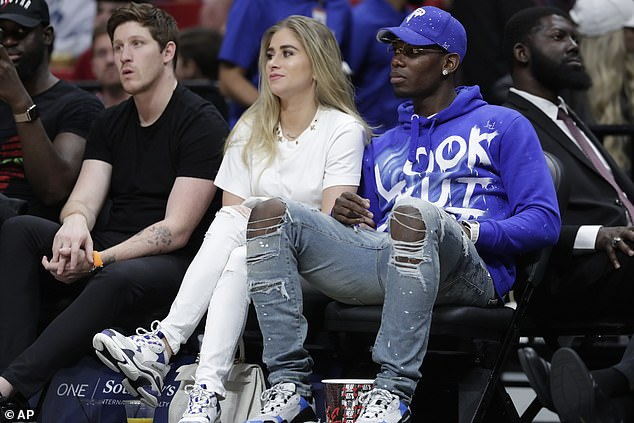 Pogba (right) was courtside to watch Butler and the Miami Heat with girlfriend Maria Salaues