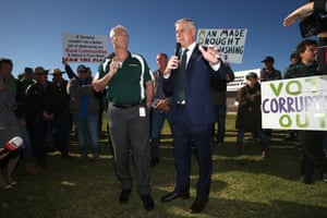 """The National party member for Nicholls, Damien Drum, and the deputy prime minister and Nationals leader, Michael McCormack, talk to farmers and protesters from the """"convoy to Canberra"""" this morning."""