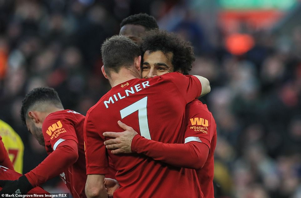 Salah is congratulated by team-mate James Milner after he scored Liverpool's second goal in their victory against Watford