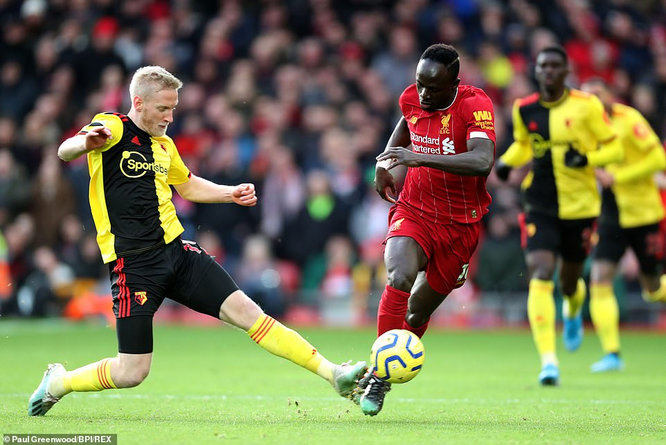 Watford midfielder Will Hughes attempts to stop Liverpool winger Mane in his tracks during an intense battle