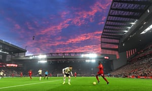 The sun sets over Anfield.