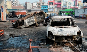 Burnt-out vehicles following clashes in New Delhi
