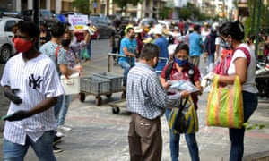 Street vendors offer their products to passersby in Guayaquil, Ecuador 20 May 2020.