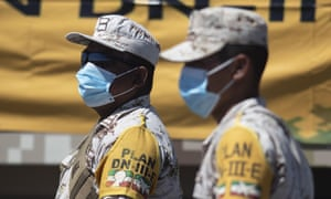Soldiers from the Mexican Army and Air Force wear face mask as equipment, material and medical supplies are unloaded from from an aircraft on 20 May, 2020 in Tijuana, Mexico.