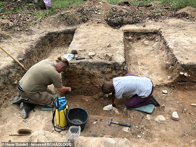 The presence of the grand axes and burial mound are indicative of members of an elite class — one capable of amassing the wealth and influence needed to construct such a monument. Pictured, archaeologists excavate the interior of the Kapellenberg hilltop enclosure in 2019