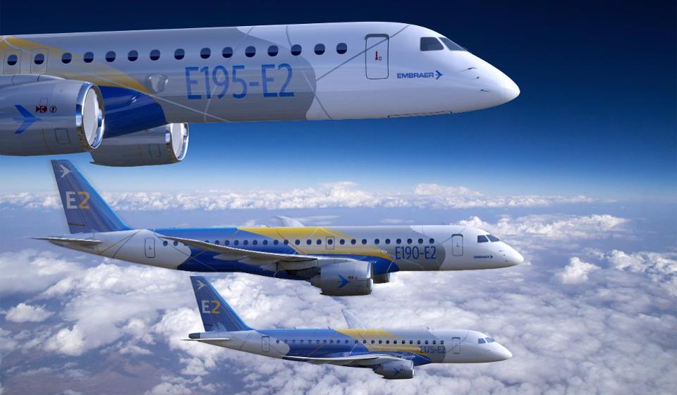 Three Embraer-branded E2 medium-range jets, flying side-by-side.