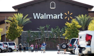 Shoppers wear face masks in the parking lot of a Walmart in Rosemead, California, this month.