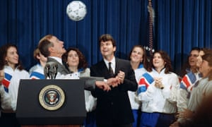 President George Bush attempts a header while meeting Anson Dorrance and his 1991 Women's World Cup champions.