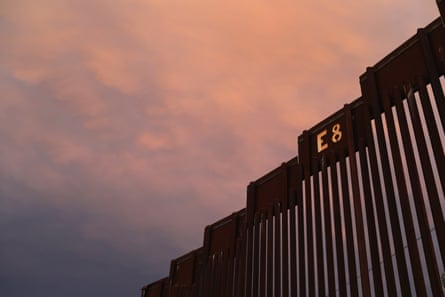 The US-Mexico border fence is seen at sunset on 22 July 2018 in Nogales, Arizona.