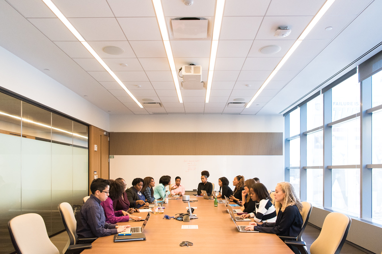 Diverse group of people at conference table
