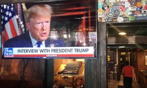 Donald Trumps pre-game Super Bowl interview with Fox News is broadcast in a bar in Washington, DC. Two ads during the game cost the campaign $180,000 a second.