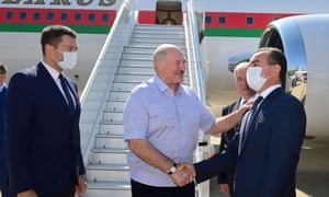 The Belarusian president, Alexander Lukashenko, greets officials during a welcoming ceremony upon his arrival at an airport in Sochi, Russia.