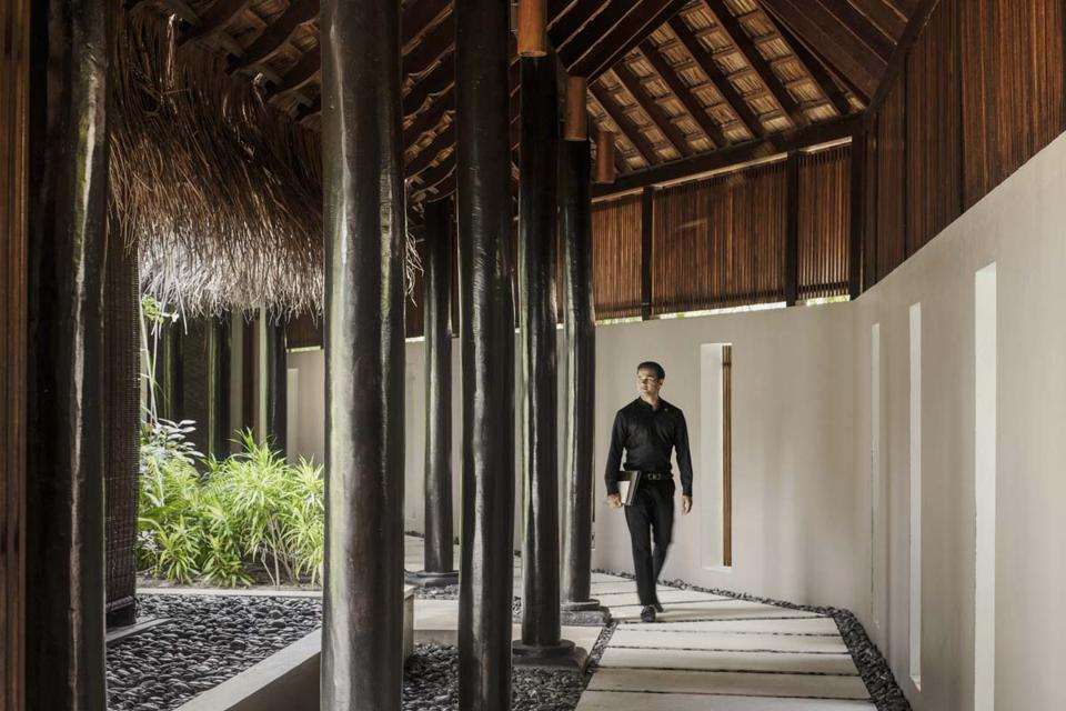 A spa worker at the Reethi Rah resort