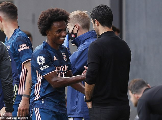 Arsenal boss Mikel Arteta praised Willian's display as they shake hands after his substitution