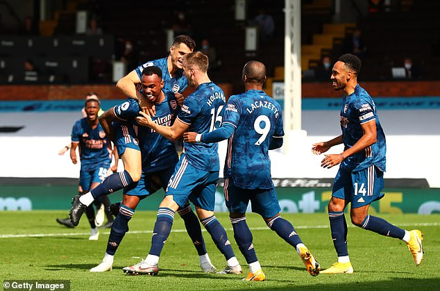 The defender was mobbed by team-mates while celebrating his goal at Craven Cottage