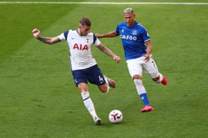 Toby Alderweireld of Tottenham Hotspur is challenged by Richarlison of Everton.