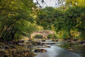 Fingle Bridge on the River Teign, near Castle Drogo in the Dartmoor National Park, Devon, England.