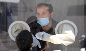 The medical team of Maccabi Health Services takes swab samples at a test station in Modi'in near Jerusalem, Israel.