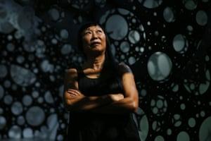 Lindy Lee poses from inside her sculptural work 'Moonlight Deities'