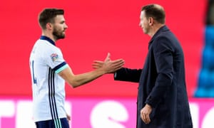 Stuart Dallas (left) with Northern Ireland manager Ian Baraclough after the game in which the Leeds defender scored an unfortunate own goal.
