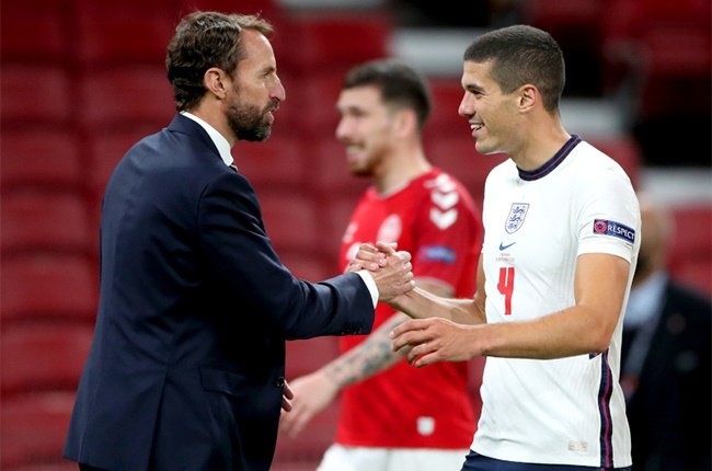 England manager Gareth Southgate (left) shakes hands with Conor Coady at the end of the UEFA Nations League Group 2, League A match at Parken Stadium, Copenhagen.
