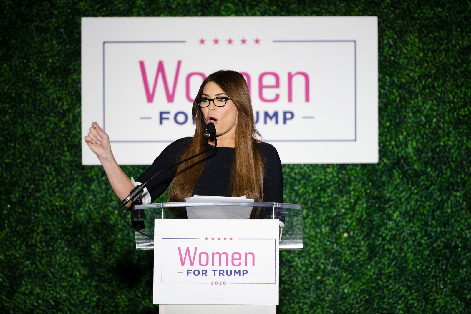 Kimberly Guilfoyle speaks in front of a Women For Trump sign.