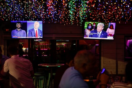 Viewers watch the dueling town halls at a restaurant in Tampa, Florida.
