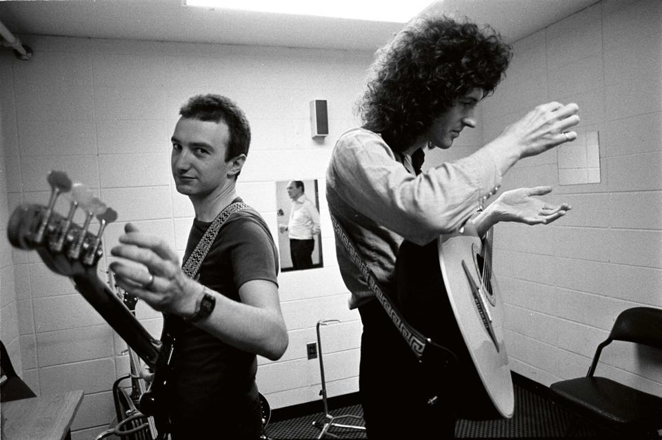 John Deacon & Brain May backstage, South America, 1981.