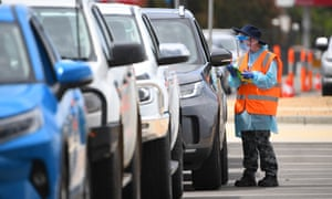 Australian Airforce personnel are seen at a drive-through Covid testing facility in Shepparton, Victoria.