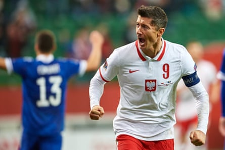 Robert Lewandowski celebrates after scoring the first of his two goals for Poland against Bosnia and Herzegovina.