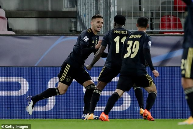 Dusan Tadic scored one goal and set up another to lead Ajax to a 2-1 win atMidtjylland