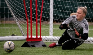 Emily Ramsey dives to save a shot during a Manchester United training session.
