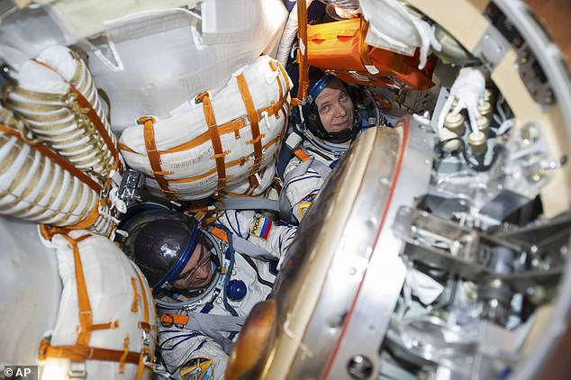 This image shows Russian cosmonauts Anatoly Ivanishin, left, and Ivan Vagner sit in the same type of Soyuz capsule that will take, and return, the Russian actress and director to the ISS
