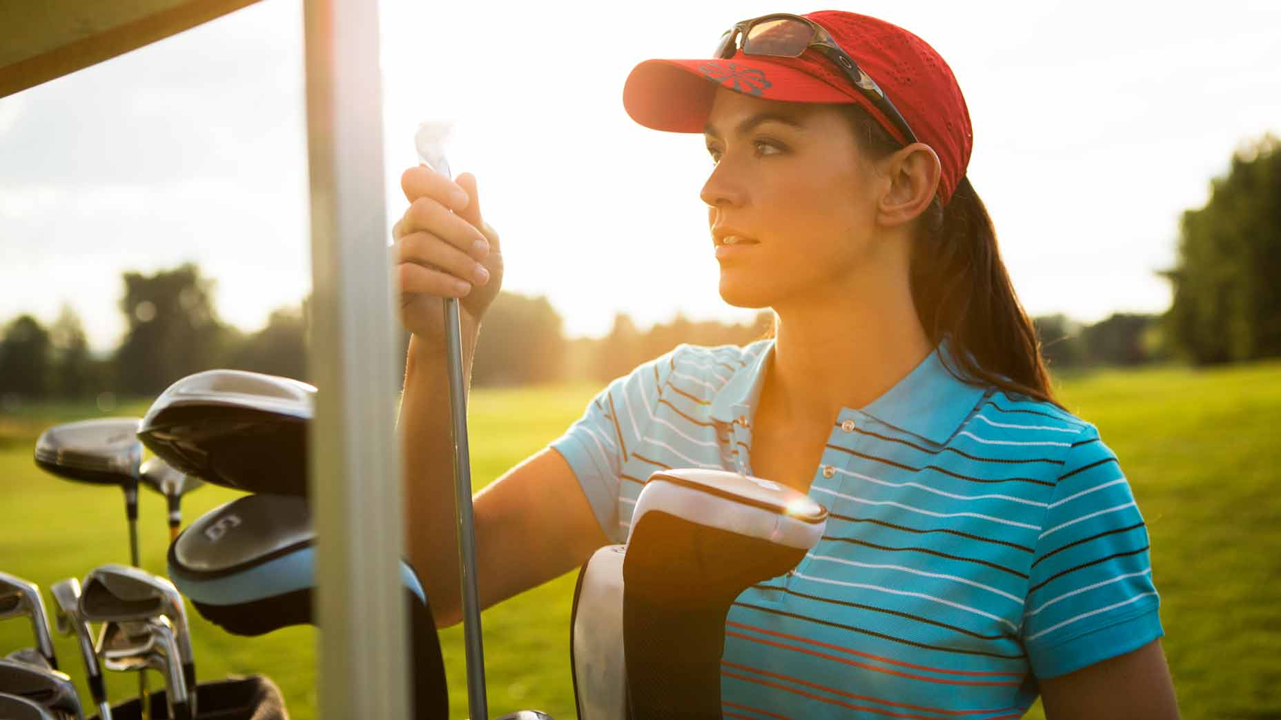 woman with golf clubs