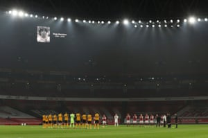 The teams during a minute's applause in memory of Diego Maradona before the match