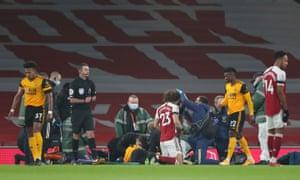 Raul Jimenez and David Luiz receive treatment after a clash of heads