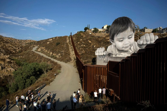 JR has taken his monumental installations around the world, including to the US-Mexico border