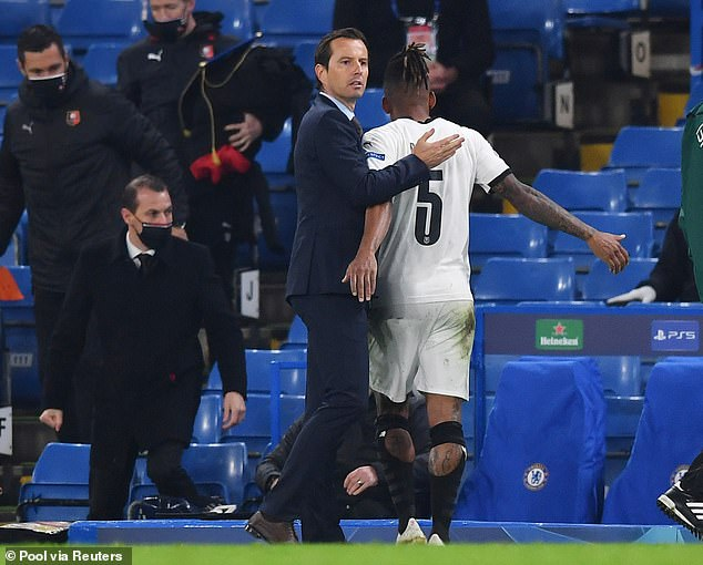 Rennes boss Julien Stephan comforts his Brazilian left-back as he trudges off after the red card