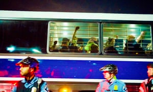 Detained demonstrators are taken to the police station by buses at the end of protest marches in Minneapolis.