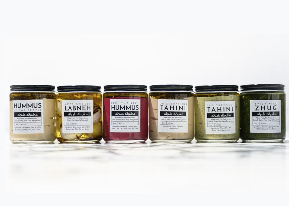 A variety of Shuk Shuka's housemade spreads and dips.