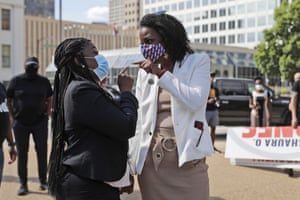 Activist Cori Bush, left, is congratulated by St. Louis City Treasurer Tishaura Jones Wednesday, Aug. 5, 2020, in St. Louis.