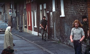 British army soldiers patrolling streets of West Belfast.