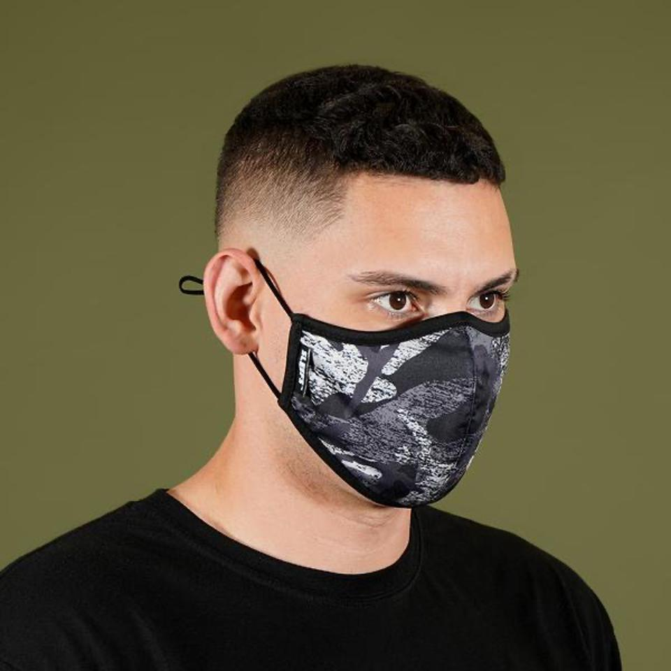 Our Gray Scraped Camo Face Mask is shaped to comfortably cover your nose and mouth. It is made of non-medical grade cloth and polyester and is reusable and washable.